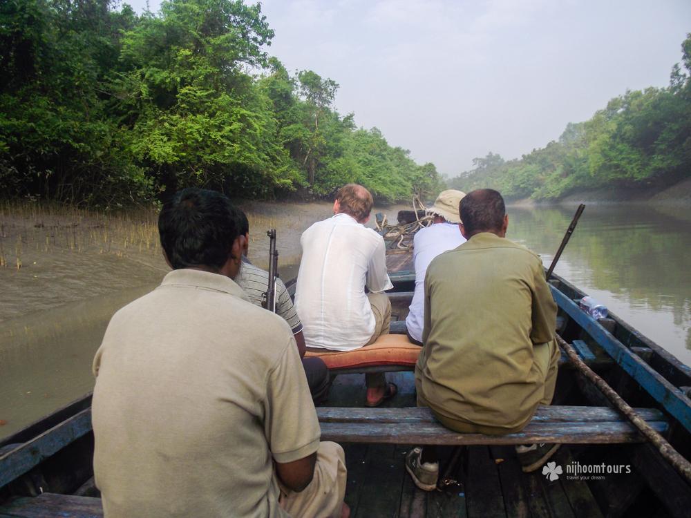 Morning boat ride at a narrow canal