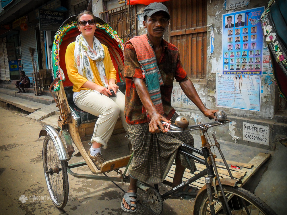 Riding rickshaw on the street of Dhaka. One of the best things to do in Dhaka.