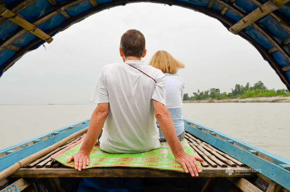 Jackie & Mike Hulton riding a boat on Meghna river