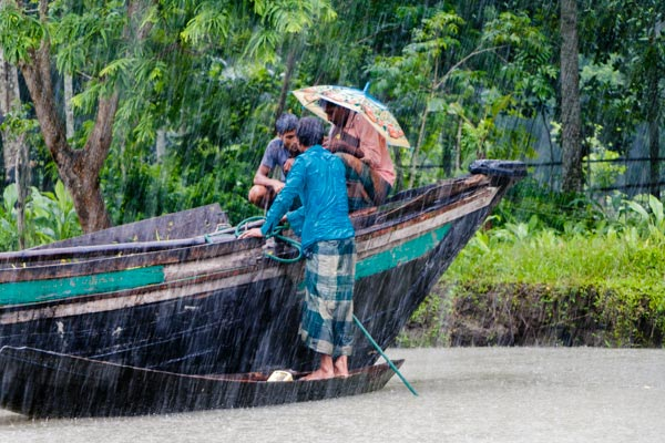 Trade on a floating market in Bangladesh during monsoon
